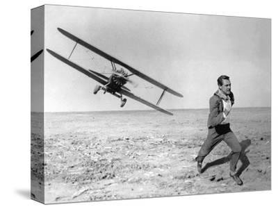 NORTH BY NORTHWEST, 1959 directed by ALFRED HITCHCOCK Cary Grant (b/w photo)--Stretched Canvas Print