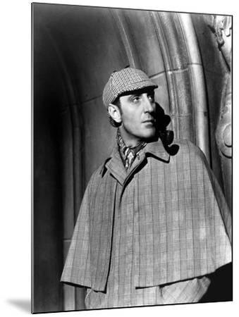 THE HOUND OF THE BASKERVILLES, 1939 directed by SIDNEY LANFIELD. Basil Rathbone (b/w photo)--Mounted Photo