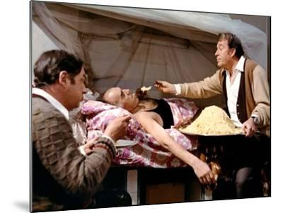 LA GRANDE BOUFFE, 1973 directed by MARCO FERRERI Philippe Noiret, Michel Piccoli and Ugo Tognazzi (--Mounted Photo