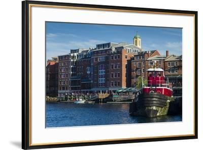 USA, New Hampshire, Portsmouth, waterfront buildings with tugboat-Walter Bibikow-Framed Premium Photographic Print