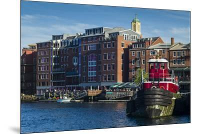 USA, New Hampshire, Portsmouth, waterfront buildings with tugboat-Walter Bibikow-Mounted Premium Photographic Print