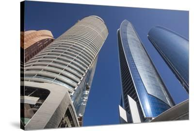 UAE, Abu Dhabi. Etihad Towers-Walter Bibikow-Stretched Canvas Print