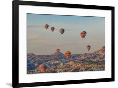 Turkey, Anatolia, Cappadocia, Goreme. Hot air balloons flying above the valley.-Emily Wilson-Framed Premium Photographic Print