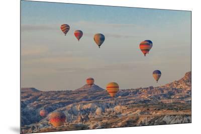 Turkey, Anatolia, Cappadocia, Goreme. Hot air balloons flying above the valley.-Emily Wilson-Mounted Premium Photographic Print