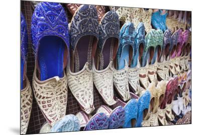 UAE, Dubai, Deira. Souvenir traditional slippers-Walter Bibikow-Mounted Premium Photographic Print