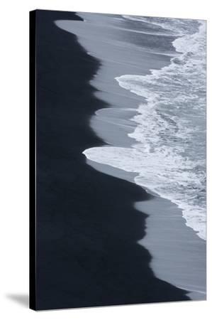 Iceland, Ingolshofdi, Water Rushing Up on Lava Sand-Hollice Looney-Stretched Canvas Print