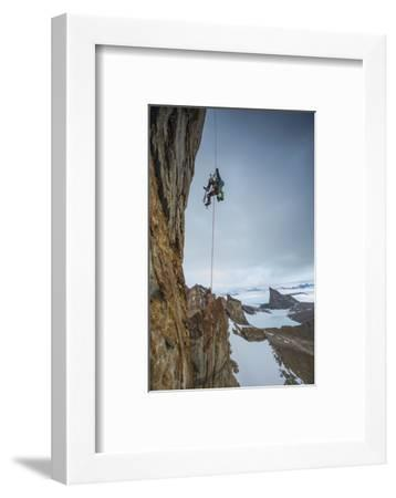An expedition team member hauls himself up Bertha's Tower in remote Queen Maud Land.-Cory Richards-Framed Photographic Print