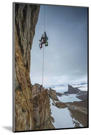 An expedition team member hauls himself up Bertha's Tower in remote Queen Maud Land.-Cory Richards-Mounted Photographic Print