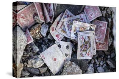 A weathered deck of playing cards at Everest's Base Camp.-Cory Richards-Stretched Canvas Print