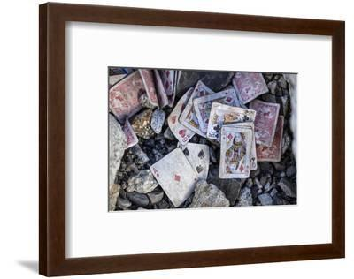 A weathered deck of playing cards at Everest's Base Camp.-Cory Richards-Framed Photographic Print