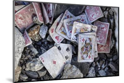A weathered deck of playing cards at Everest's Base Camp.-Cory Richards-Mounted Photographic Print