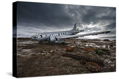 The wreckage of an Ilyushin-14T cargo plane at an old Soviet weather research outpost-Cory Richards-Stretched Canvas Print