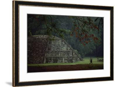 Mayan pyramidal tomb showing silhouetted Pancho the monkey who lives at the site.-Kenneth Garrett-Framed Photographic Print