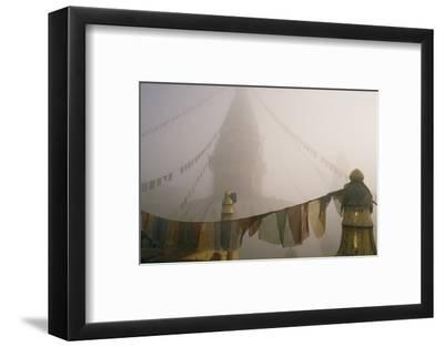 A temple and prayer flags shrouded in fog.-David Edwards-Framed Photographic Print