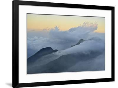 Clouds covering the peaks of the Sierra Nevada Mountains.-Kike Calvo-Framed Photographic Print