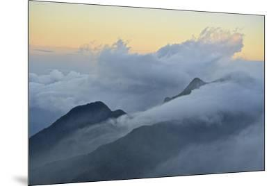 Clouds covering the peaks of the Sierra Nevada Mountains.-Kike Calvo-Mounted Photographic Print