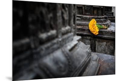 A bouquet of yellow flowers at the stone columns of Swayambhunath.-Martin Edstrom-Mounted Photographic Print