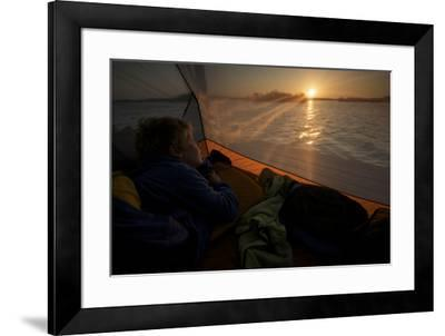 7 year old waking up at sunrise in tent on the in the mangroves.-Tim Laman-Framed Photographic Print