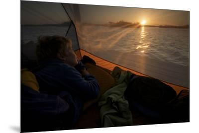 7 year old waking up at sunrise in tent on the in the mangroves.-Tim Laman-Mounted Photographic Print
