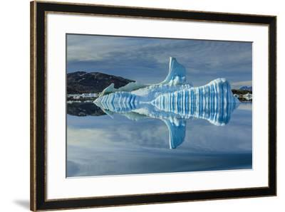 Sculpted iceberg and reflection in Semerlik Fjord.-Ralph Lee Hopkins-Framed Photographic Print