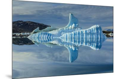 Sculpted iceberg and reflection in Semerlik Fjord.-Ralph Lee Hopkins-Mounted Photographic Print