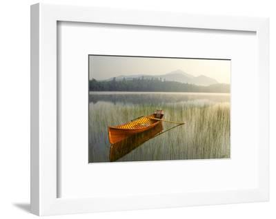 An Adirondack Guide Boat in a Calm Lake with Whiteface Mountain in the Background-Michael Melford-Framed Premium Photographic Print