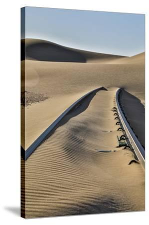 Africa, Namibia, Garub, Railroad Tracks and Drifted Sand-Hollice Looney-Stretched Canvas Print
