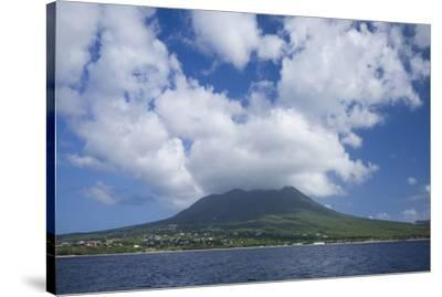 St. Kitts and Nevis, Nevis. View of Nevis Peak from the sea-Walter Bibikow-Stretched Canvas Print