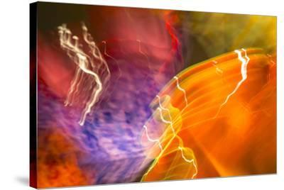 Colorful glass with blurred motion effect.-Stuart Westmorland-Stretched Canvas Print