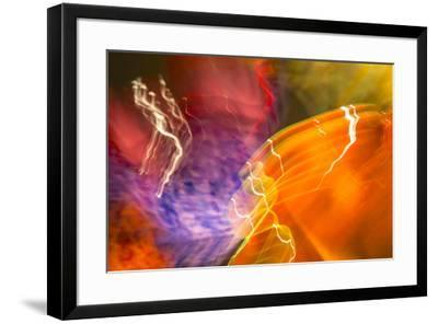 Colorful glass with blurred motion effect.-Stuart Westmorland-Framed Photographic Print