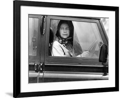Queen Elizabeth II at the wheel of her Land Rover-Associated Newspapers-Framed Photo