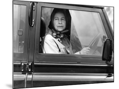 Queen Elizabeth II at the wheel of her Land Rover-Associated Newspapers-Mounted Photo