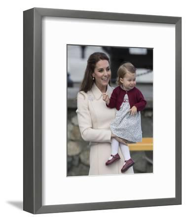 Princess Charlotte held by her mother Kate-Associated Newspapers-Framed Photo