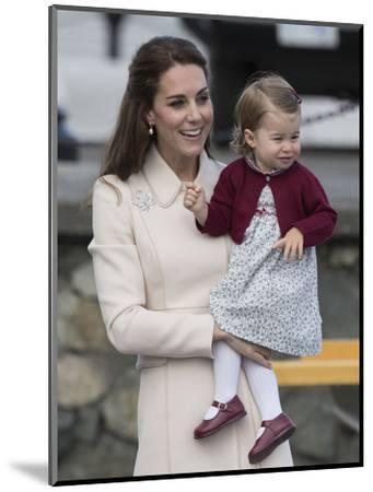 Princess Charlotte held by her mother Kate-Associated Newspapers-Mounted Photo