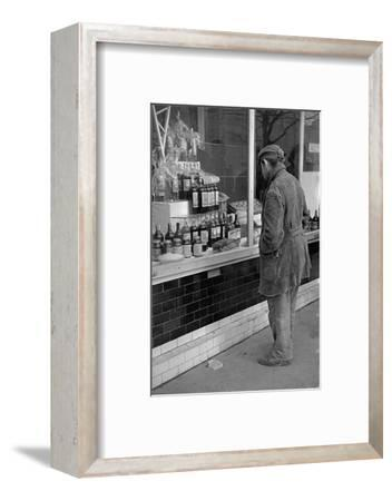 Some people can merely admire the goods which have reappeared in Belgrade shops. Belgrade,1952.-Erich Lessing-Framed Photographic Print
