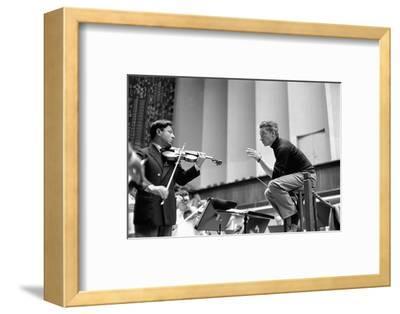 Conductor Herbert von Karajan rehearsing with Nathan Milstein in Lucerne, Switzerland. Lucerne,1957-Erich Lessing-Framed Photographic Print