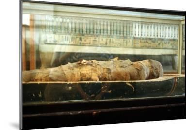 Mummy wrapped in bandages and lying on the base of a coffin, Ancient Egyptian. Artist: Unknown-Unknown-Mounted Giclee Print