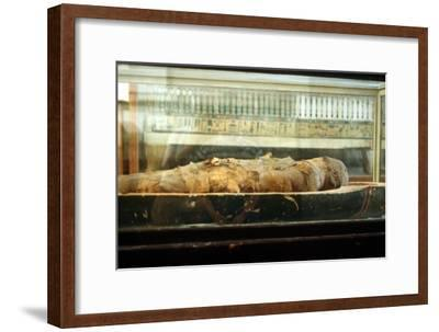 Mummy wrapped in bandages and lying on the base of a coffin, Ancient Egyptian. Artist: Unknown-Unknown-Framed Giclee Print