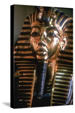 Gold mask of Tutankhamun on his mummy-case. Artist: Unknown-Unknown-Stretched Canvas Print