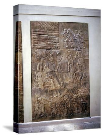 Assyrian relief showing transport of timber by land, Khorsabad, c8th century BC. Artist: Unknown-Unknown-Stretched Canvas Print