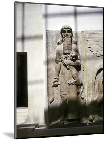 Assyrian sculpture of a man holding a lion, Khorsabad, c8th century BC. Artist: Unknown-Unknown-Mounted Giclee Print