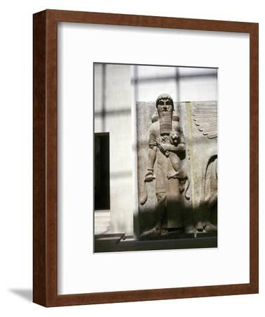 Assyrian sculpture of a man holding a lion, Khorsabad, c8th century BC. Artist: Unknown-Unknown-Framed Giclee Print