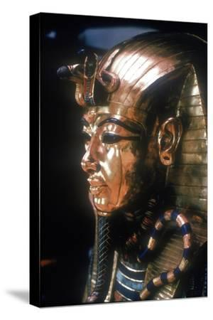 Gold mask of Tutankhamun on the second coffin. Artist: Unknown-Unknown-Stretched Canvas Print