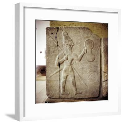 Hittite relef of a Hittite warrior or war-god with shield spear and sword. Artist: Unknown-Unknown-Framed Giclee Print