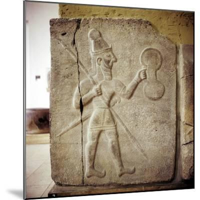 Hittite relef of a Hittite warrior or war-god with shield spear and sword. Artist: Unknown-Unknown-Mounted Giclee Print