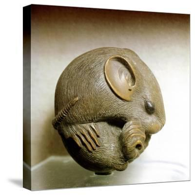 Netsuke carved in the form of a rat, one of the 12 animals of the Japanese zodiac. Artist: Unknown-Unknown-Stretched Canvas Print
