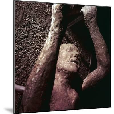 Plaster Cast of a victim of the eruption of Vesuvius at Pompeii, Italy. Artist: Unknown-Unknown-Mounted Giclee Print