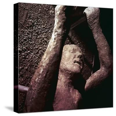Plaster Cast of a victim of the eruption of Vesuvius at Pompeii, Italy. Artist: Unknown-Unknown-Stretched Canvas Print