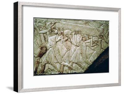 Egyptian relief of men moving a stone lintel. Artist: Unknown-Unknown-Framed Giclee Print