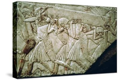 Egyptian relief of men moving a stone lintel. Artist: Unknown-Unknown-Stretched Canvas Print